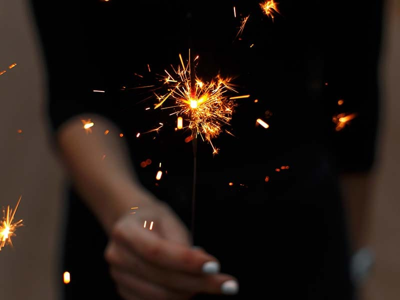 search for change lady having a lilted sparkler